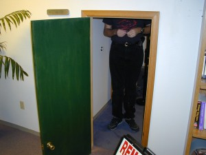 Standing in door